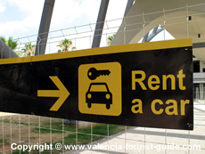 Sign pointing to the rental cars at Valencia Airport